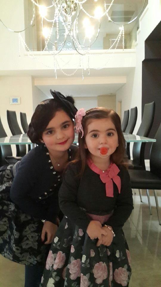 Beautiful sisters dressed in Monnalisa
