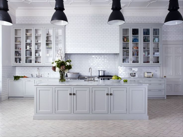 Wow! the marble, the large island, stone herringbone floor, chalky greys, metro tiles...Beautiful