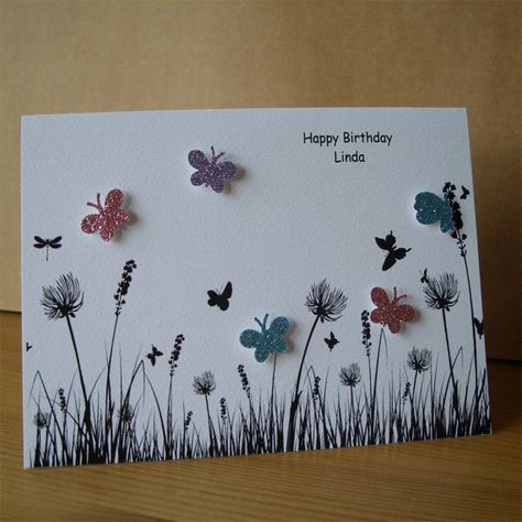An ideal card for any occasion.    Approximately A6 textured white card with blank white insert and envelope all protected in a cellophane packet.    This card has been created using a digi stamp printed onto quality textured card and then embellished with pink, blue and lilac glittered butterflies.