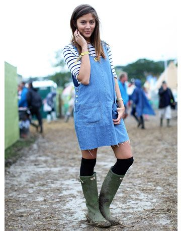 A frayed denim jumper, Breton stripe tee and those ubiquitous Hunter wellies kept this showgoer looking quite adorable despite the muddy grounds.    - HarpersBAZAAR.com