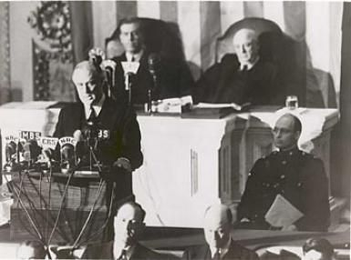 Picture of President Franklin Roosevelt delivering his Day of Infamy speech. - (Public domain) on December 8, 1941.