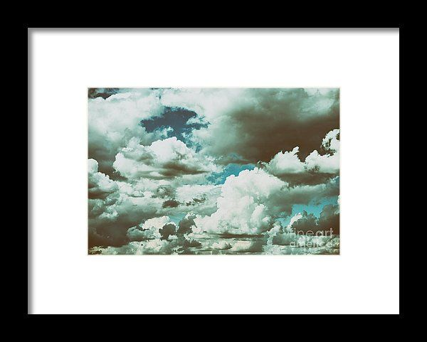 White Cumulus Clouds And Grey Storm Clouds Gathering On Blue Sky Framed Print