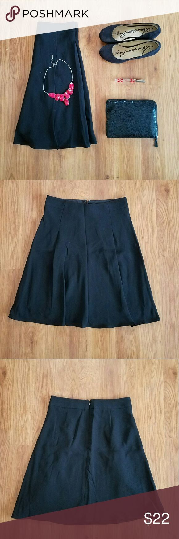 The Limited black high waist skater skirt A few big pleats in front. Zipper in center back. Lining on the inside. 100% polyester. The Limited Skirts Circle & Skater