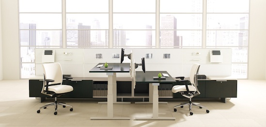 Teknion Livello. Same workstation, back to back with the adjustable height tables. It can be done!
