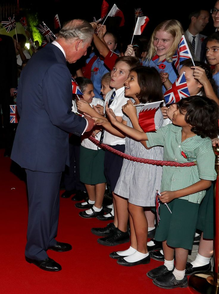 Prince Charles Photos Photos - Prince Charles, the Prince of Wales is greeted by schoolchilden as he attends a reception at the British Embassy on November 10, 2016 in Manama, Bahrain. The Prince of Wales and the Duchess of Cornwall are on a Royal tour of the Middle East which began with Oman, the UAE and finally Bahrain. - The Prince of Wales and The Duchess of Cornwall Tour Bahrain - Day 3