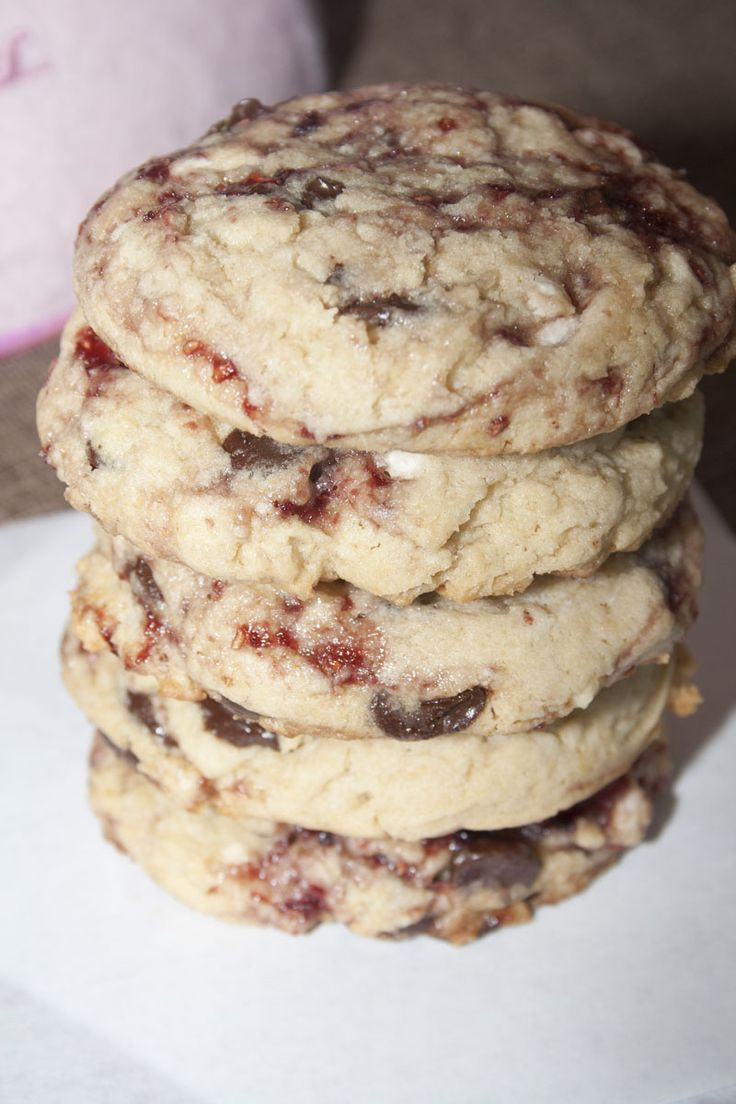 Disneyland's White Chocolate Raspberry Cookie Recipe ~ Says: This cookie. A light sweet dough with white and chocolate chips swirled with raspberry. Bliss. Usually when something is overhyped as being simply divine, the real thing doesn't measure up. I cannot express to you how excited I was when at first bite I realized Disneyland's White Chocolate Raspberry Cookie was everything I wanted it to be and more. It is beyond delicious.