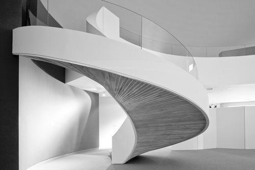 The sensuous curves of a staircase inside the Centro Niemeyer by Oscar Niemeyer.