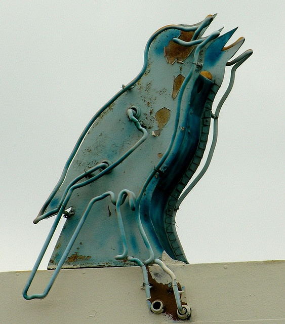 Vintage neon bird sign for The Melody Ranch Motel at 943 W Holt Blvd in Ontario, CA.