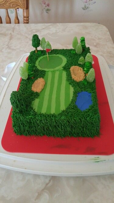 Golf course with pond and trees. Had a blast making this cake!