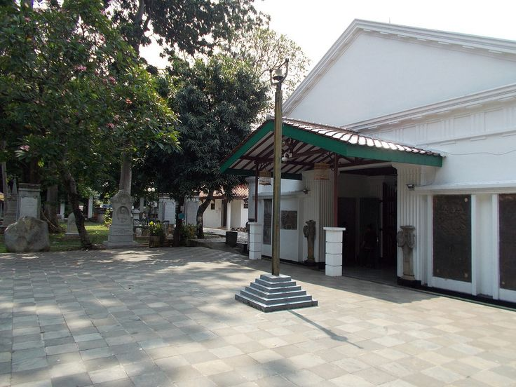 Central Yard of Museum Taman Prasasti in Petojo, Jakarta. A cemetery bell can be seen in front of the main building.