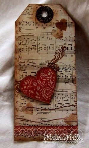 by ethel- love the distressed background in monotone distress. Makes the heart pop off the tag with color!