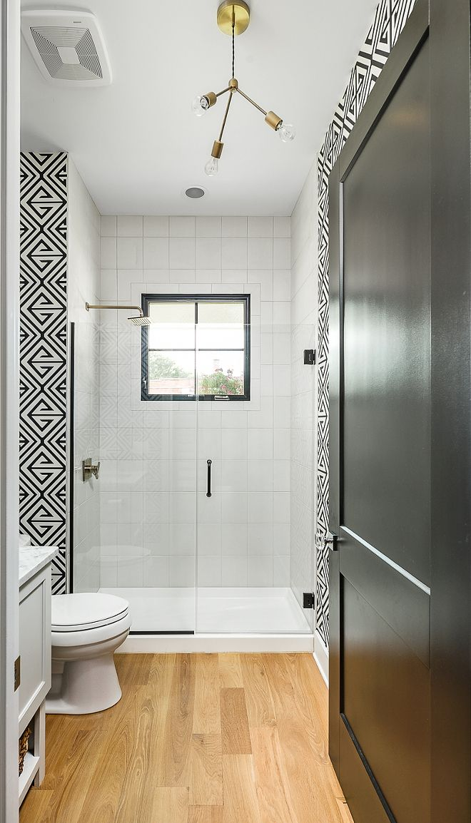 Black And White Creates A Modern Look In This Farmhouse Bathroom