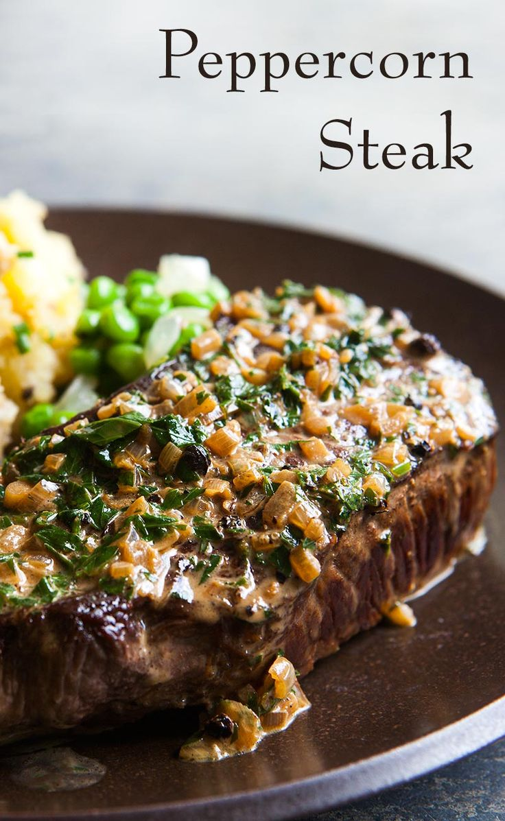Classic Peppercorn Steak! No need to go to a steak house, you can easily make at home! Seared thick steaks, sprinkled with crushed peppercorns, and served with a creamy peppercorn sauce. On SimplyRecipes.com