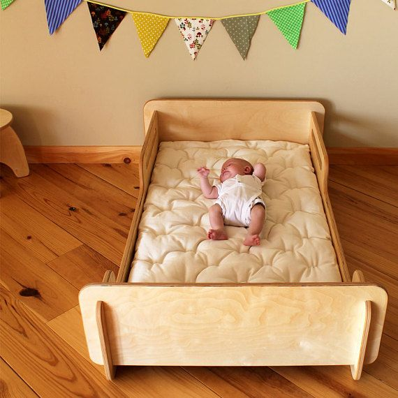This toddler bed is made with durable child-safe Baltic Birch multi layer wood plies. It is shipped completely disassembled and simply slides together without any need for fasteners. It fits a standard 28 x 52 crib mattress. This piece is sanded satin smooth and finished with a natural