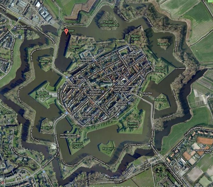 Naarden, Netherlands, Naarden, is a Spanish 'star fort', a walled town with fortified walls and vantage points shaped like arrow heads sticking out into a double ring of moats.