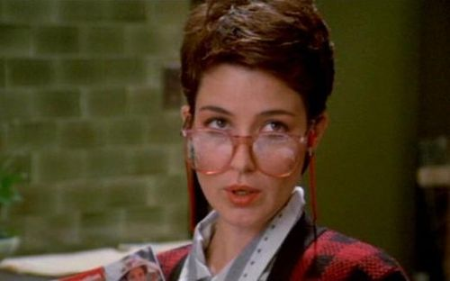 ((Fc/ Annie Potts)) Hello, I'm Janine. The Ghostbusters secretary. I've gotten calls about all kinds of crazy, call us anytime and I'll be answering your calls. I love reading and I'm kinda social. Come call for an appointment.