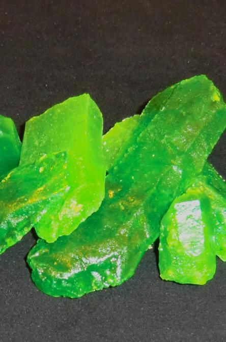 """Recipe For Kryptonite Candy - Just in time for the release of """"Man of Steel"""", we here at STL Cooks have discovered the ULTIMATE candy for anyone who is a huge Superman fan...Kryptonite candy! Not only does it look like the stuff from the movies, it also glows under UV lights, and if done right; in regular light too!"""