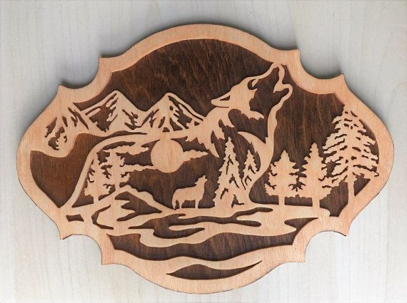 This wolf nature scene is a wooden plaque to hang on your wall.  Get just this one for $40 or get a set of three for $100.