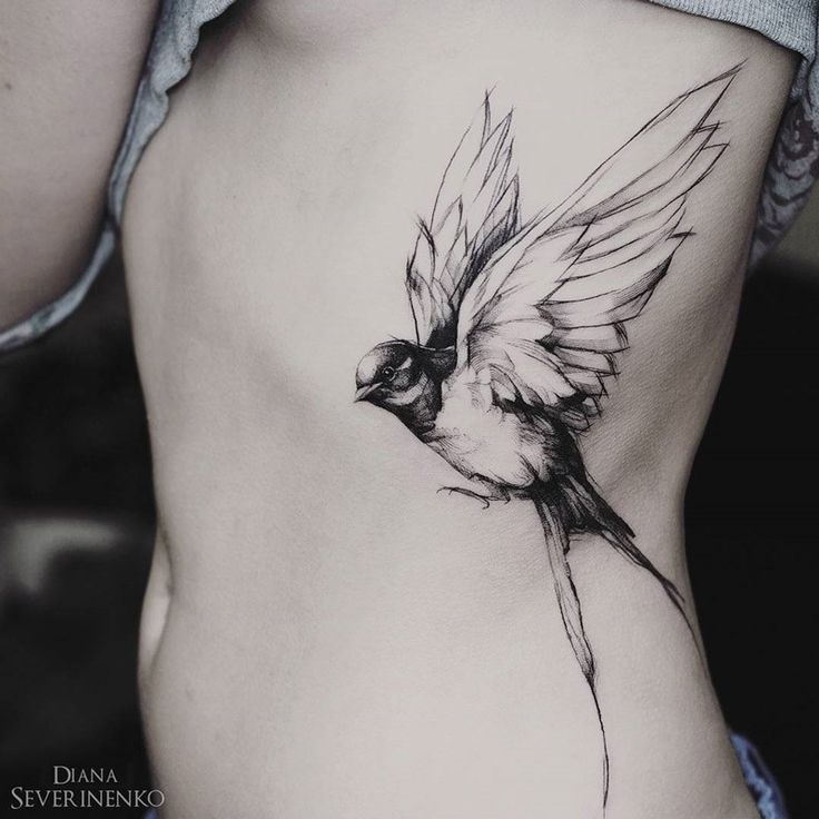 Pretty swallow in flight, girls side tattoo done with black ink in a sketch style. This lovely bird piece is by Diana Severinenko, an artist based in Kiev, Ukraine. (Beauty Art Tattoo)