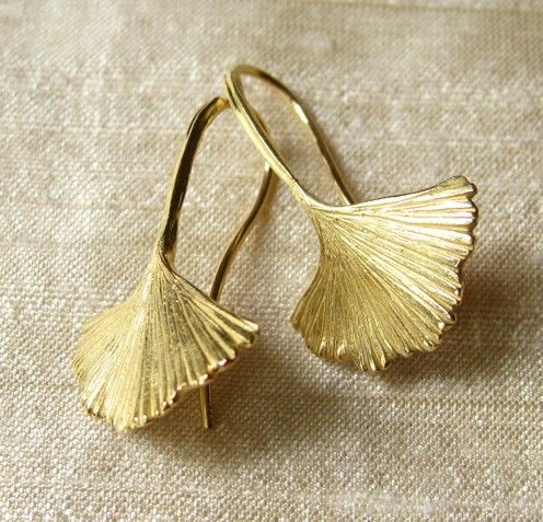 Distinctive in their fernlike appearance, ginkgo biloba leaf earrings are cast in 18k gold. The ancient Ginkgo tree is one of the oldest living tree species.    Artists have been inspired by the beautiful unusual form and texture of Ginkgo leaves for centuries