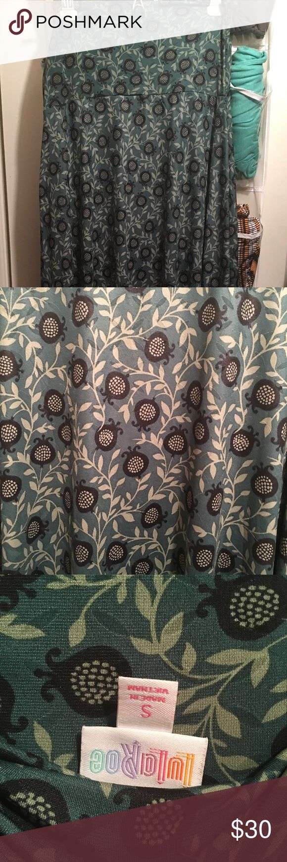LuLaRoe Maxi Skirt/Dress (Small) EUC Worn once and washed according to LLR standards, this maxi is in EXCELLENT used condition. The material is has a leatherette feel, and it's more slinky than cottony. The design is like dark navy flower buds and vines on a blue-green background. If you're familiar with LLR, you know a Small can fit up to a 14/16 comfortably, even tough the chart suggests 2-4. I'm a bigger woman, and this skirt has PLENTY of stretch. 🐶DISCLOSURE: my pets don't smoke, but I…