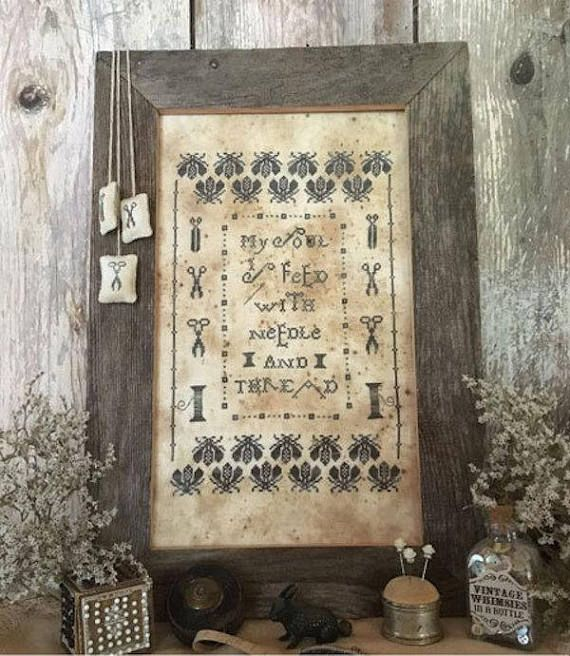 Cross Stitch Pattern called A Stitchers Sampler, by Isabella Abbiati of The Primitive Hare. Pattern includes: floss list / symbols 1 graph color photo Grid size: 136W x 193H Stitch Count: 130 x 188 Design by Primitive Hare from Italy. New Unused Copy from our Shop. Patterns