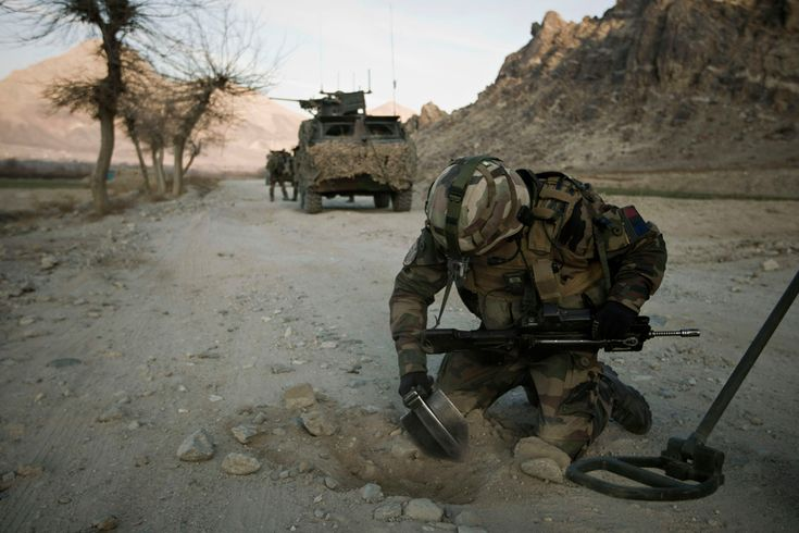 A mine clearing specialist from the French Foreign Legion searches for improvised explosive devices on a road near Tagab in Kapisa Province on Jan. 25. The French Foreign Legion, a military unit established in 1831, was created for foreign nationals of any nationality wishing to serve in the French armed forces. (Joel Saget/AFP/Getty Images) #