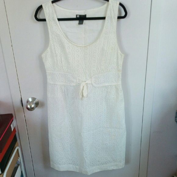 WEEKEND SALE White Eyelet Dress ACCEPTING ALL REASONABLE OFFERS  ASK ME ABOUT BUNDLE OPTIONS   White Eyelet Dress. Worn a few times. Some discoloration, as pictured. Carole Little Dresses