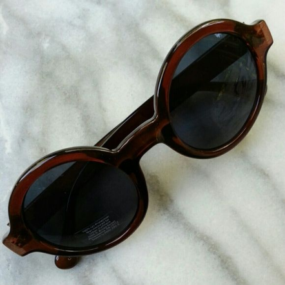 Autumn Preppy Round Sunglasses Round shades with dark gray lenses and chocolate brown frames. 100% UVA/UVB protection. Urban Outfitters Accessories Sunglasses