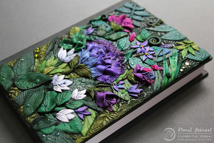 Elaborate book covers have been Aniko Kolesnikova's passion since 2009. The Latvian designer-artist, working under the name Mandarin Duck, specializes in creating dragon-, animal-, bird-, fantasy-, and nature-inspired polymer journals. She occasionally takes custom orders, too.