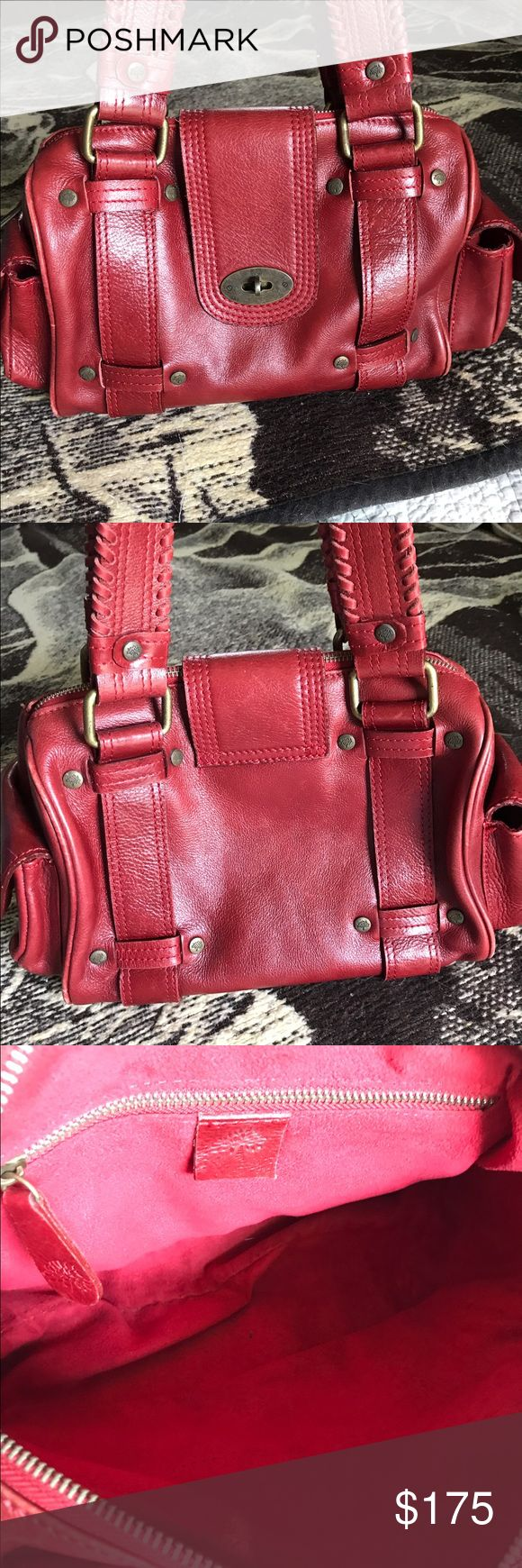 Authentic Mulberry Satchel Beautiful red Mulberry Satchel. Authentic and vintage. Has 2 pockets on either end and one zip pocket inside. There is light scuffing on the corners, as shown, but the bottom is great. Very clean on the inside. Mulberry Bags Satchels