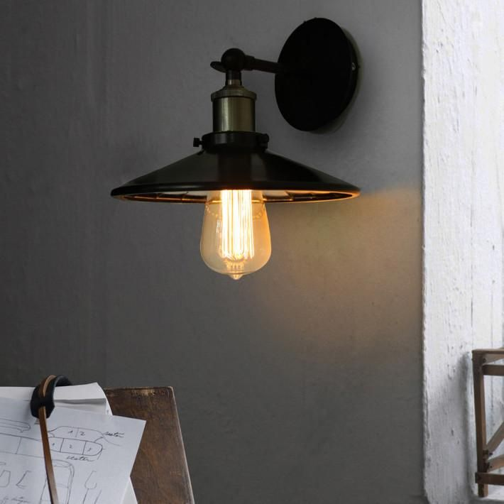 Vintage industrial look wall sconce light. With black lamp shade with mirror inside. Perfect for bare Edison filament bulb. Brass bulb holder E27. Articulated arm. Number of bulbs 1 Power 60W, 110 - 240V Fitting type E27 Material Metal Colour Black & Bronze Measurements 22cm D x 15cm H Total package weight 1.2 kg Total packagedimensions 31*25*15cm Compatibility: This light is compatible to be used in: USA 110volt EU / UK 220~240volt AU / NZ220~240volt Free Shipping Eligi...