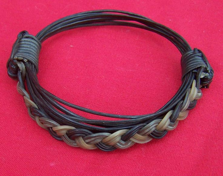 JJ5T  3inc Diameter6 strands of dark hair with a unique weave between the knots. Price $260 incl ship & ins