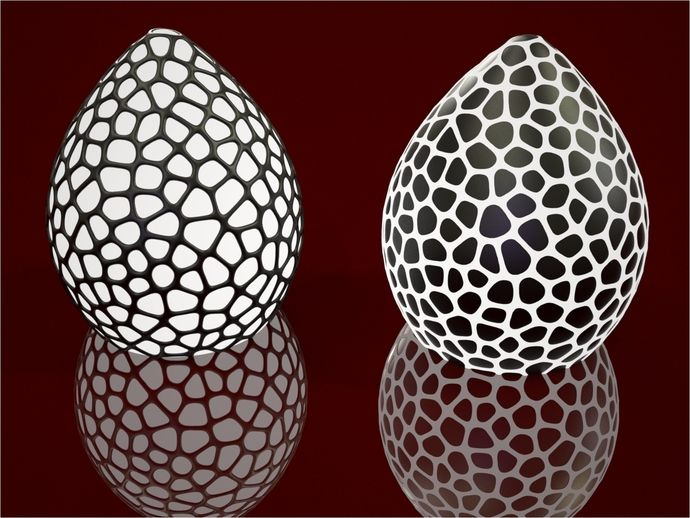 """Inspired by a dragon's egg.. or what they could look like if you imagined one ;-)    Design intended for dualstrusion, but monostruders, do not despair:   You can print """"Net"""" or """"Surface"""" as standalones.    Circa 11 cm high, scale as needed.    So there are two different models:   One where the pattern is embedded near the surface.  (Left)   And one where the pattern is completely embedded in the shell.  (Right)"""