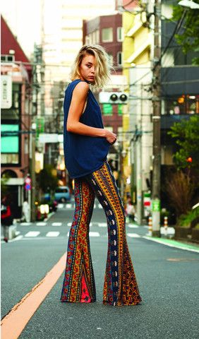 These palazzo pants are similar to those seen during the 70's. Her oversized shirt and patterns in the pants also pay tribute to the 70's and ethnic, earthy styles. -Dominique Norman