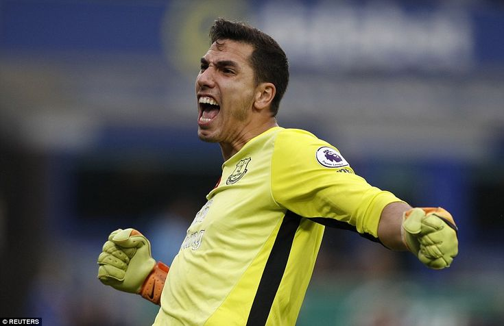 Everton goalkeeper Joel Robles punches the air in celebration after Barkley put his side two goals clear
