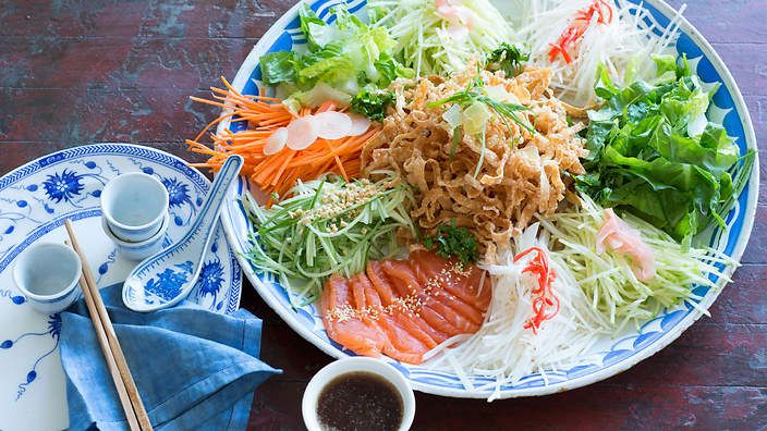A colourful platter of shredded vegetables, pickled ginger, salmon and a tasty sauce, prosperity toss (yee sang) is traditionally eaten at Lunar New Year feasts. Listen to the audio recipe.