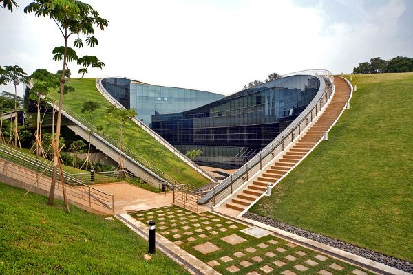 The Nanyang Technological University of Singapore recently erected a green roof building to house their School of Art, Design and Media.  The five story structure features two curved sections with stretches of green roof fully accessible to students.  In the Nanyang School of Art, the line between landscape and building are blurred.  Beyond the aesthetic value of this green roof design, this living skin saves heating and cooling costs and collects rainwater for landscape irrigation.
