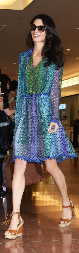 Amal Clooney wore a bright crochet Missoni sundress when she touched down in Tokyo. She completed her outfit with Valentino tassel-adorned wedges, Prada sunglasses, and a neutral bag.