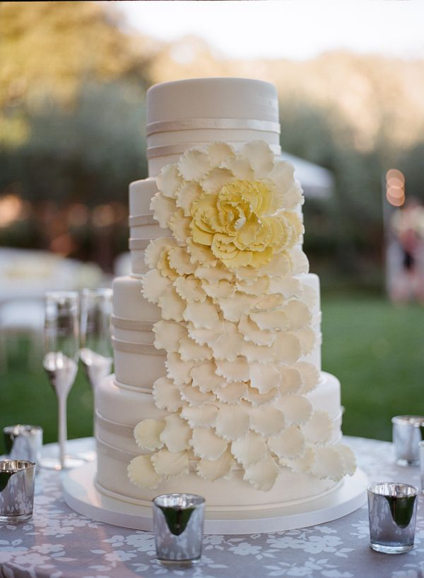 Classic four tiered wedding cake by Perfect Endings.   Photo by Meg Smith.