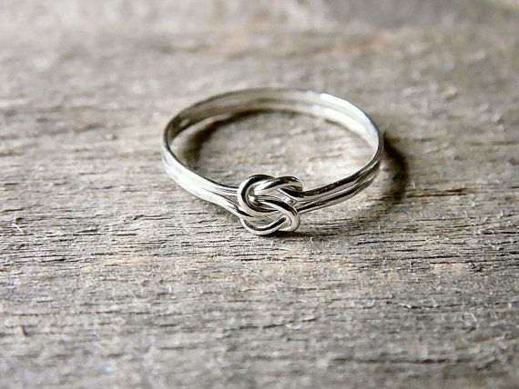 Two handmade love knot rings have been intertwined to make this double knot ring. Made entirely of sterling silver, this ring is great for everyday