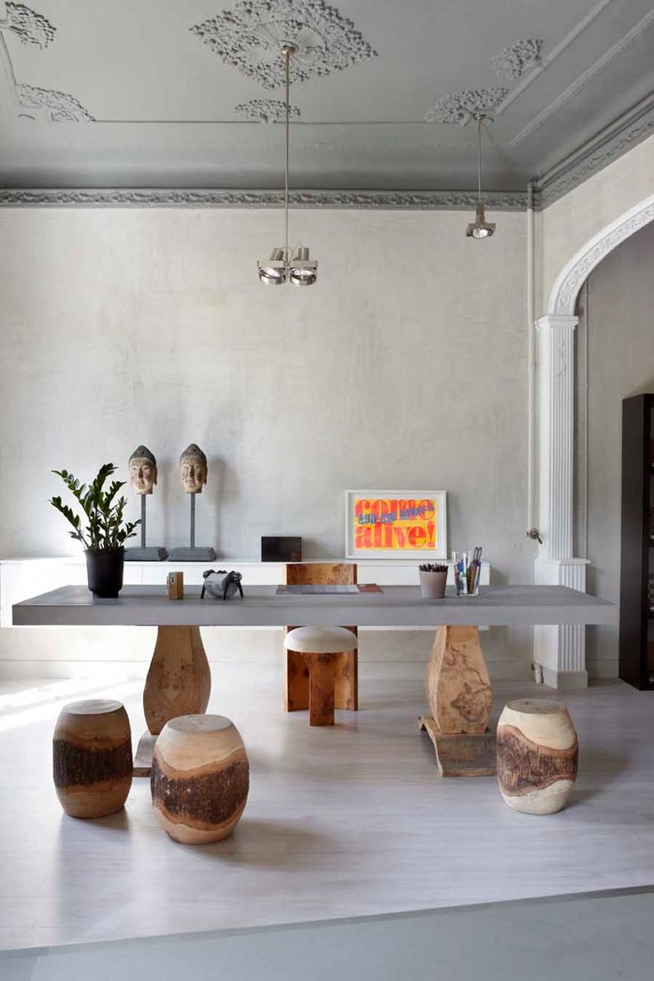 French house style transforms to an architectural office for Stones and Walls HQ - cool office desk area