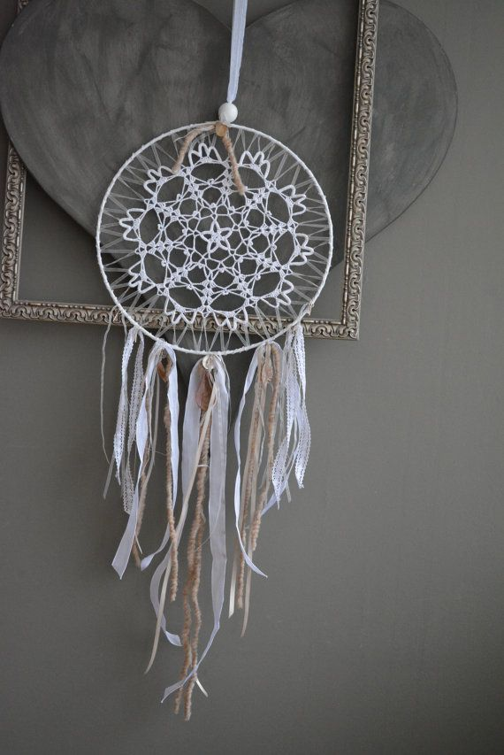 A vintage lace doily dream catcher in creme  white and by SierGoed, €27.95