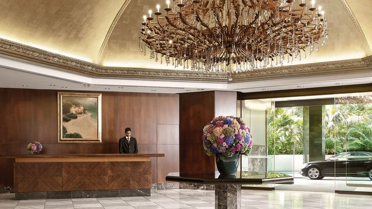 The luxurious lobby and stunning chandelier at The Langham, Auckland