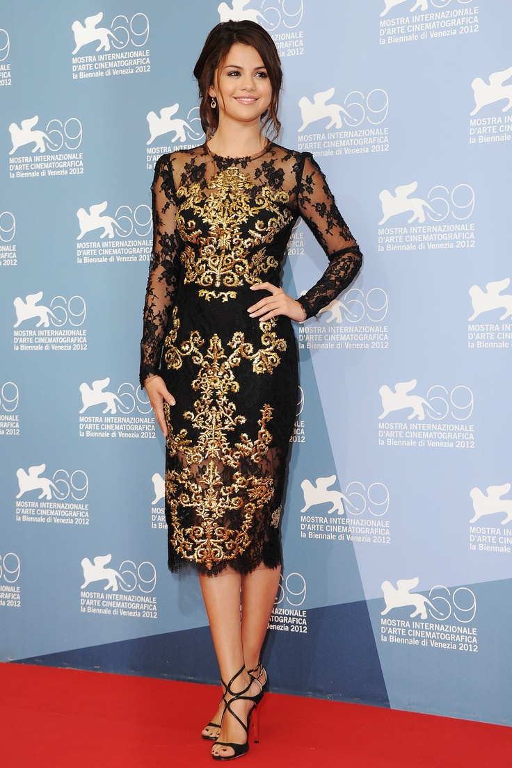 Selena Gomez in Dolce & Gabbana cocktail dress, Melinda Maria Jewelry earrings and strappy Jimmy Choo sandals.at the 'Spring Breakers' Venice Film Festival Photocall