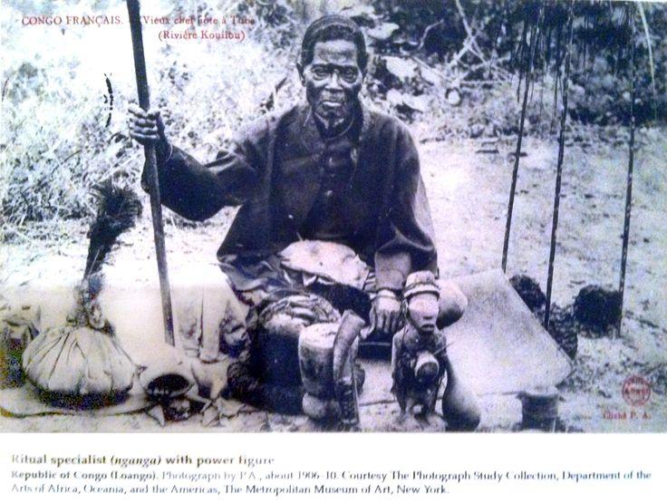 Ritual specialist (nganga) with power figure. Republic of Congo. Photograph in MFA, Boston. Power figure (Nkisi n'kondi). Kongo peoples (Democratic Republic of the Congo). c. late 19th century C.E. Wood and metal.