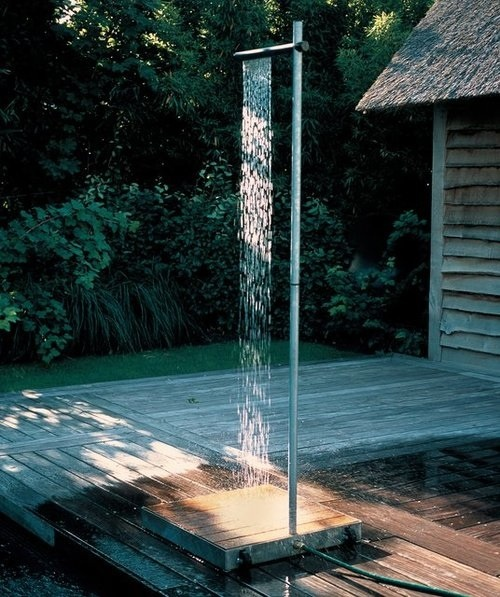 love the idea of outdoor showers, but then you are naked outdoors!!