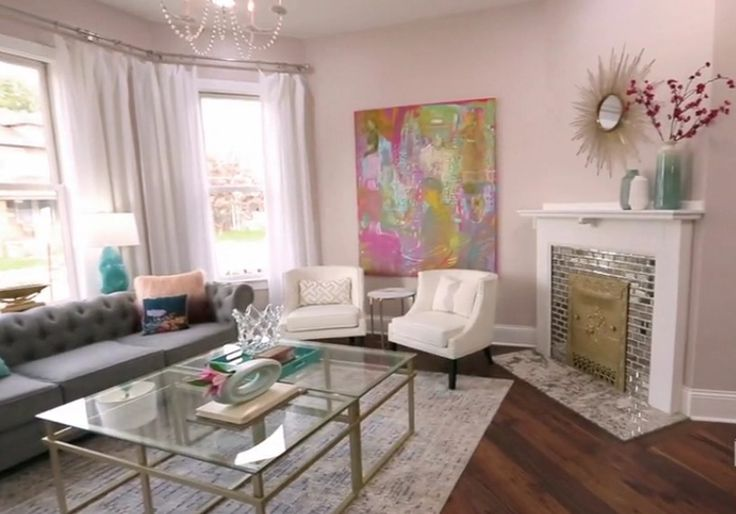 """Pretty pretty little sitting room. Love the mirror tile on the fireplace. Those chairs are divine. From HGTV's show called """"good bones."""""""