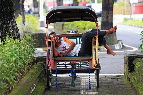 Exhausted becak driver