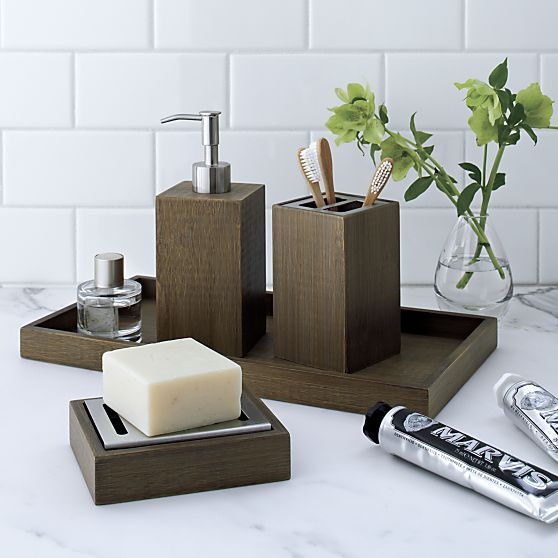 Eco-friendly bamboo goes at right angles as clean-lined, natural bathroom accessories. Each beautifully crafted piece glows with a warm grey finish. Soap pump has rustproof zinc pump and conceals a 9-ounce refillable plastic bottle.